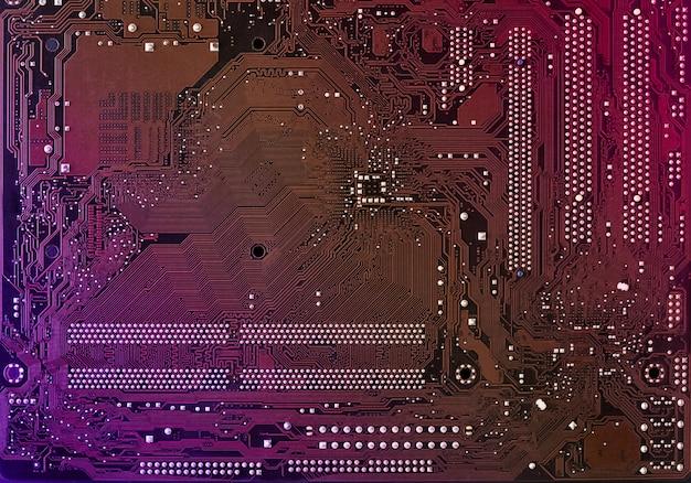 Placa-mãe do computador com borrão brilho multicolor de néon, pano de fundo do pc