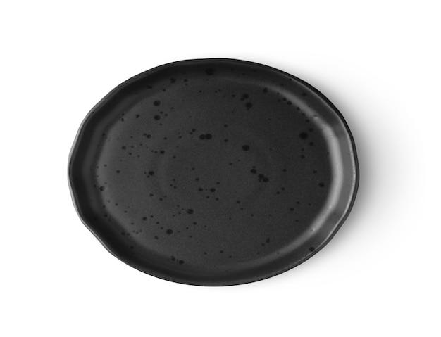 Placa preta isolada na vista superior do fundo branco