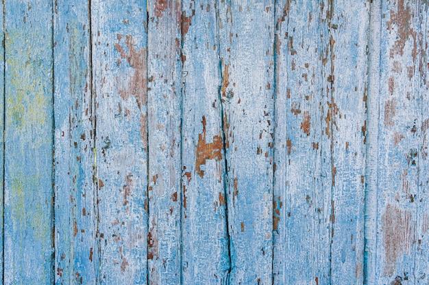 Placas rachadas pintadas velhas, vista superior. textura de madeira.