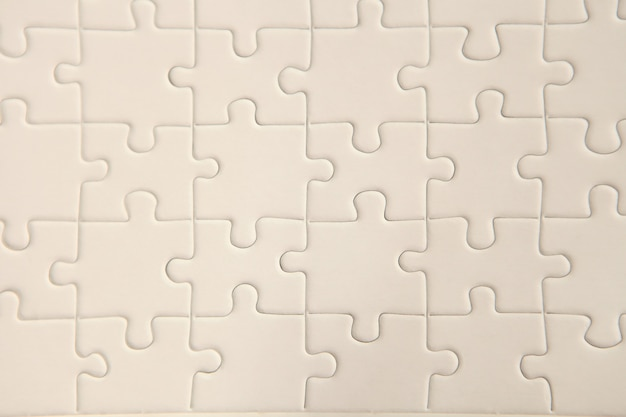 Planeje a superfície branca do quebra-cabeça para um background texturizado e papel de parede abstrato. copie o espaço para o texto
