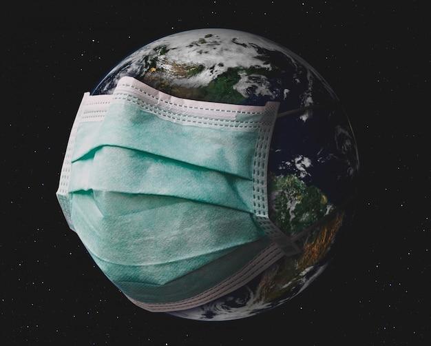 Planeta terra com máscara cirúrgica.