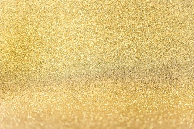 Plano aproximado de fundo de glitter dourado