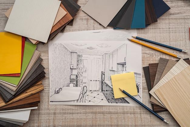 Plano arquitetônico com paleta de amostras de cores, designer trabalhando. conceito de renovação