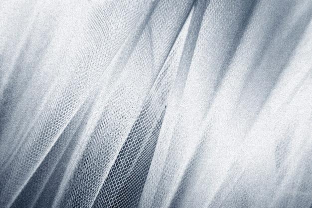 Plano de fundo com textura de pele de cobra de tecido prateado sedoso