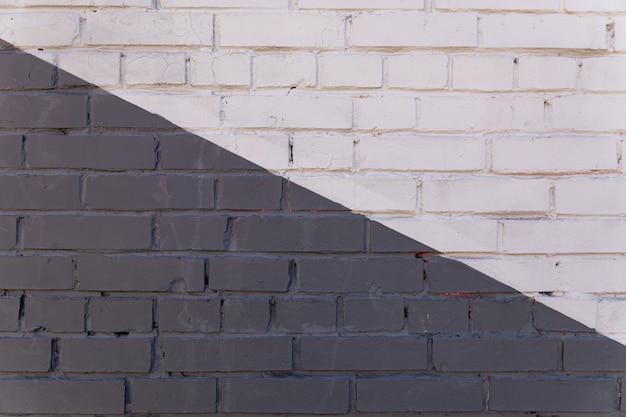 Plano de fundo da parede de tijolo pintado de cinza, pano de fundo texturizado. copie o espaço para designers.