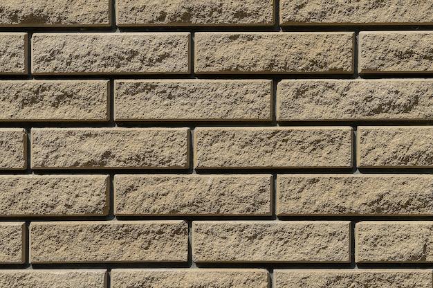 Plano de fundo da parede de tijolos de arenito.