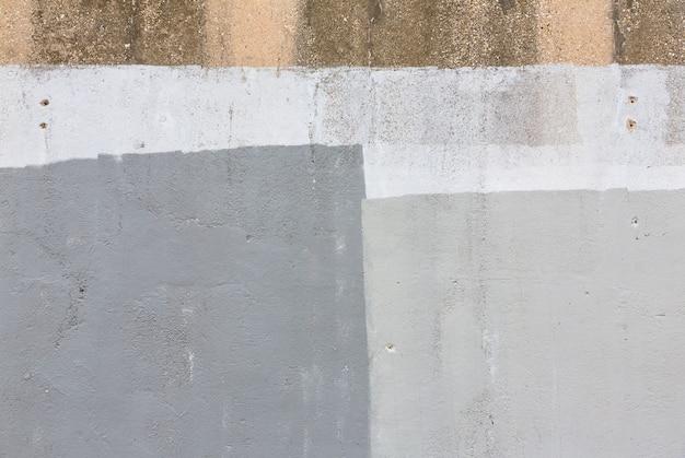 Plano de fundo da velha parede pintada de cinza. fundo envelhecido da parede da rua, textura.