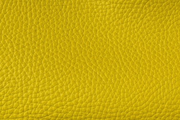Plano de fundo de couro amarelo texturizado closeup, grão grande