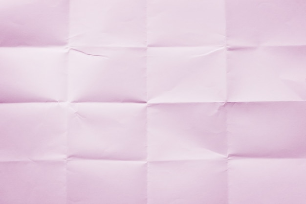 Plano de fundo de folha de papel rosa amarrotada