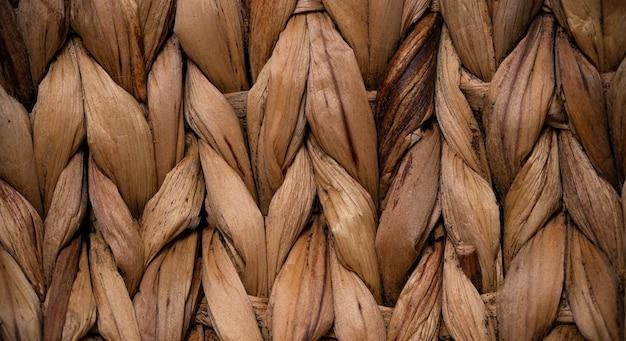 Plano de fundo de grama de vime seca texturizada close-up.