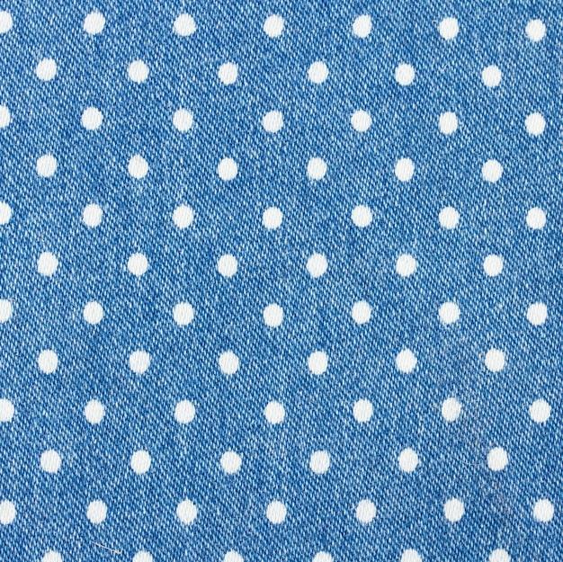 Plano de fundo de jeans azul com padrão de bolinhas brancas