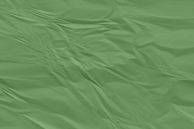 Plano de fundo de papel verde amassado acima