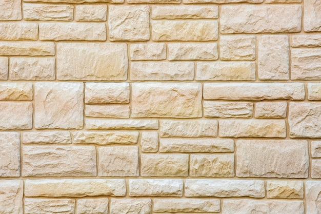 Plano de fundo de telhas de pedra marrom natural, parede de tijolos de mármore