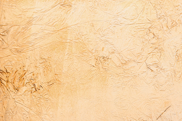 Plano de fundo de um estuque amarelo revestido e pintado exterior, elenco bruto de cimento e parede de concreto textura