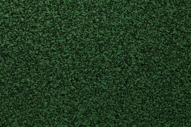 Plano de fundo liso verde escuro granulado da mesa. superfície abstrata de textura com pequeno padrão de migalhas para design de interiores e bancada de cozinha.