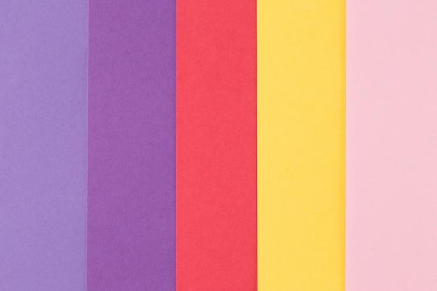 Plano de fundo multicolorido de um papel de cores diferentes, vista superior