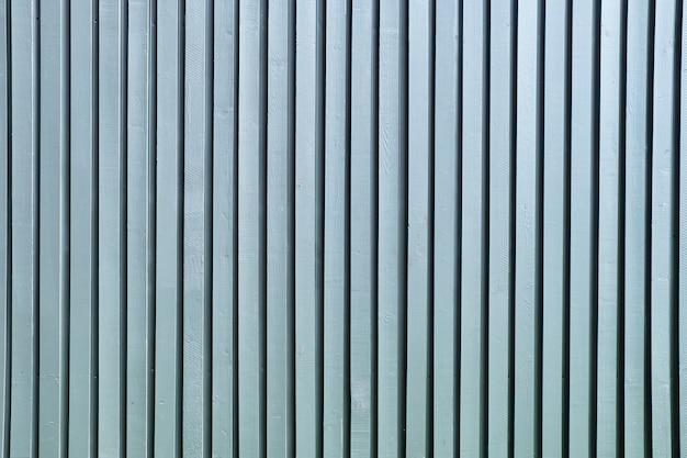 Plano de fundo oportuno de varas de madeira de cor cinza