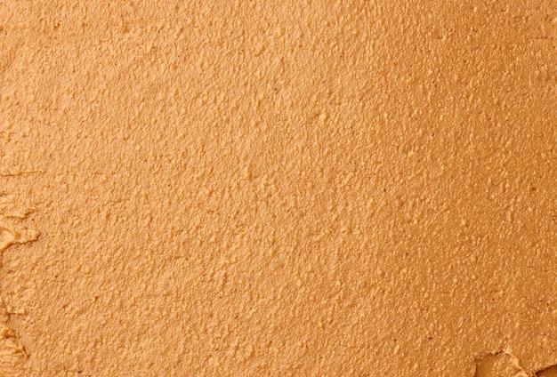 Plano de fundo simples de pasta de amendoim, vista superior