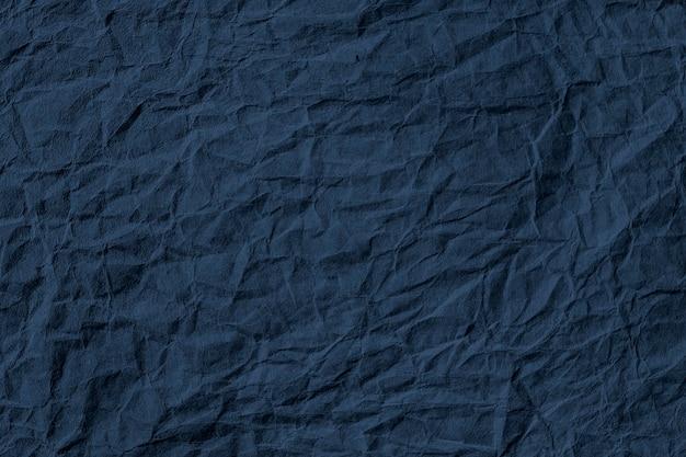 Plano de fundo texturizado amassado de papel azul escuro