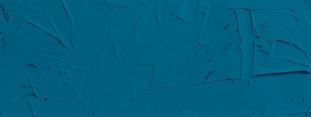 Plano de fundo texturizado azul de pasta de preenchimento aplicado com espátula em traços e traços irregulares