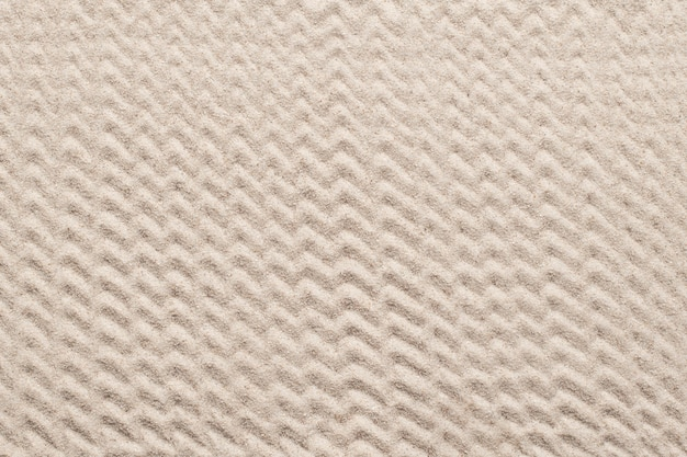 Plano de fundo texturizado de areia com padrão de ziguezague no conceito de bem-estar