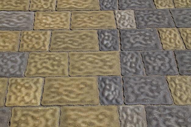 Plano de fundo texturizado de calçada. detalhe de um pavimento