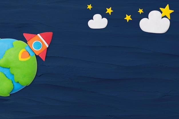 Plano de fundo texturizado de foguete espacial em argila de plasticina azul para crianças