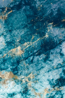 Plano de fundo texturizado de mármore azul e dourado