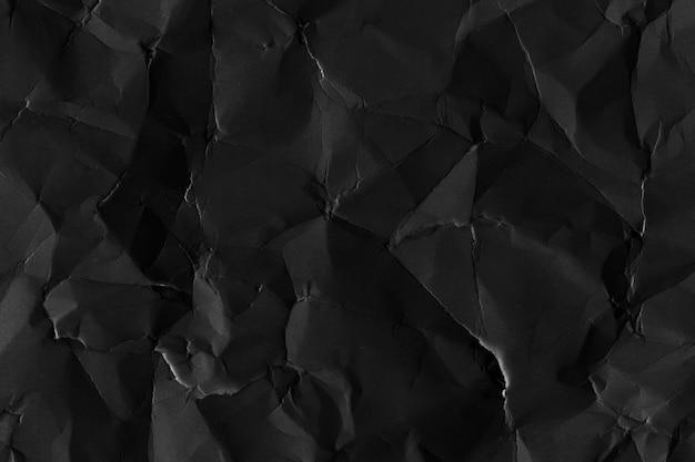 Plano de fundo texturizado de papel preto amassado