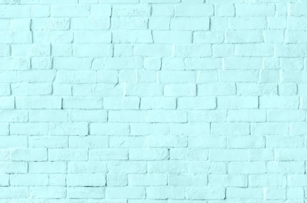 Plano de fundo texturizado de parede de tijolo azul pastel