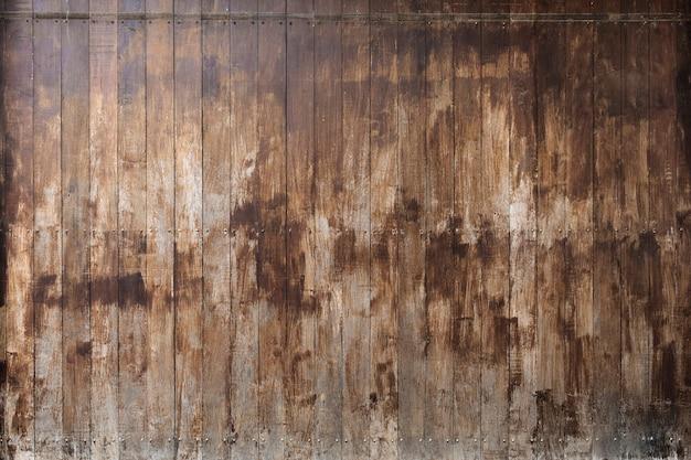 Plano de fundo texturizado de pranchas de madeira grunge Foto gratuita