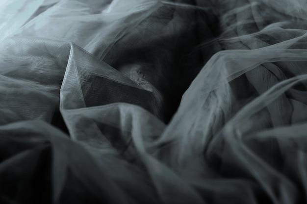Plano de fundo texturizado de tecido de tule chiffon. saia plissada textura de tecido. closeup plisse textura de tecido padrão