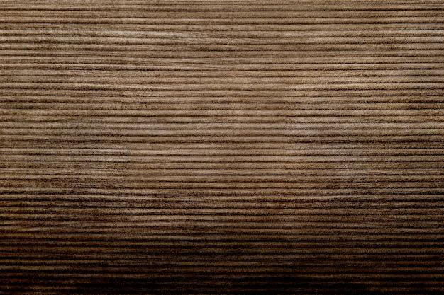 Plano de fundo texturizado de tecido de veludo cotelê marrom