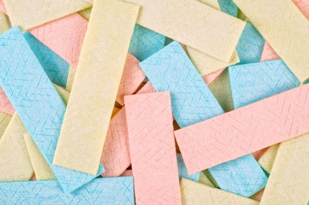Plano de fundo texturizado muitos pratos de goma de mascar