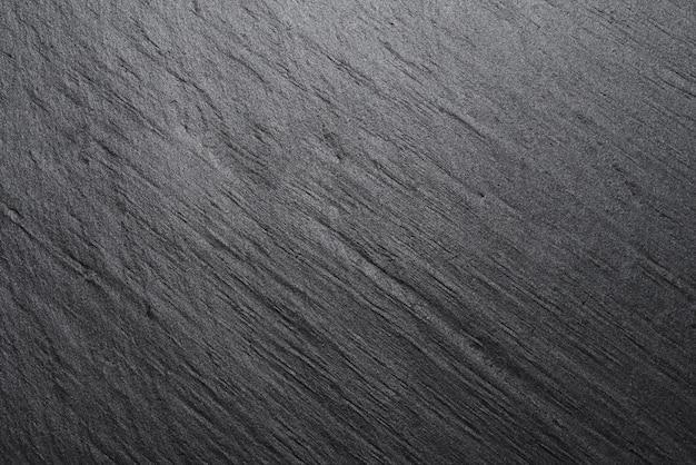 Plano de fundo texturizado ou textura de ardósia preta cinza escura.