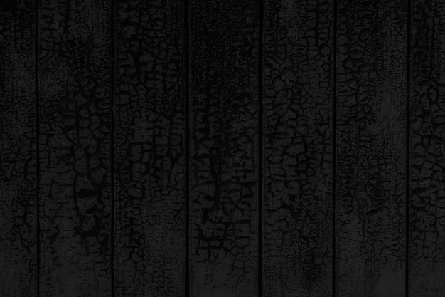 Plano de fundo texturizado preto da parede de madeira pintada rachada