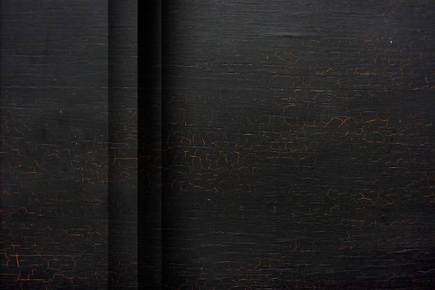Plano de fundo texturizado preto de madeira rachado