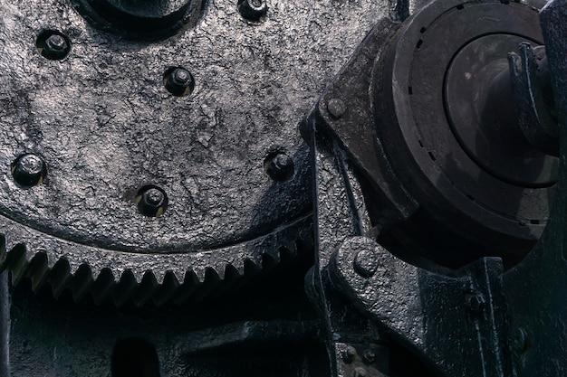 Plano de fundo - um fragmento de um enorme mecanismo negro da era do vapor