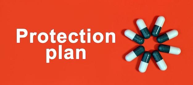 Plano de proteção - texto branco sobre fundo vermelho com cápsulas de comprimidos