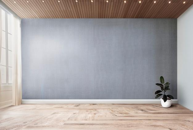 Planta em uma sala vazia com maquete de parede cinza