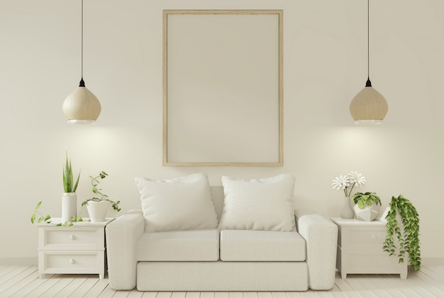 Plantas do sofá e da decoração na sala de visitas com parede branca.