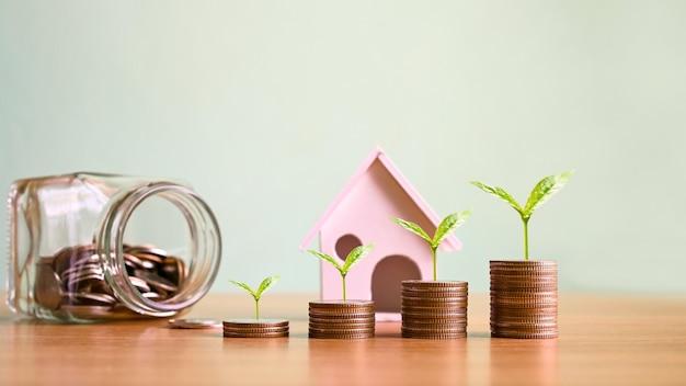 Plantas que crescem a partir de uma pilha de moedas ideias de investimento imobiliário