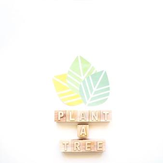 Plante uma inscrição de árvore e folhas coloridas