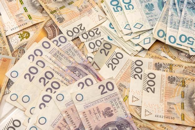 Pln polonês dinheiro como pano de fundo para o projeto. conceito financeiro