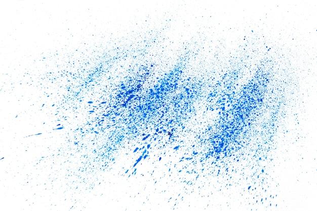 Pó azul sobre fundo branco