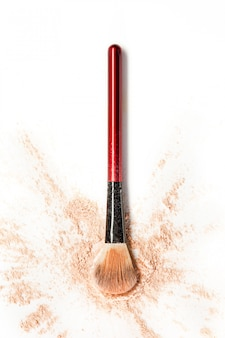 Pó de brilho mineral triturado com pincel de maquiagem