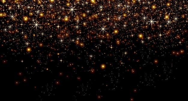 Pó de ouro e estrelas de bokeh em um fundo preto, conceito de natal e férias felizes