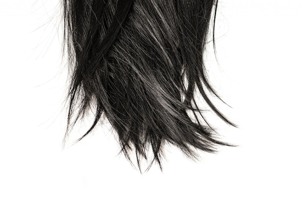 Pontas do cabelo preto isoladas no branco.