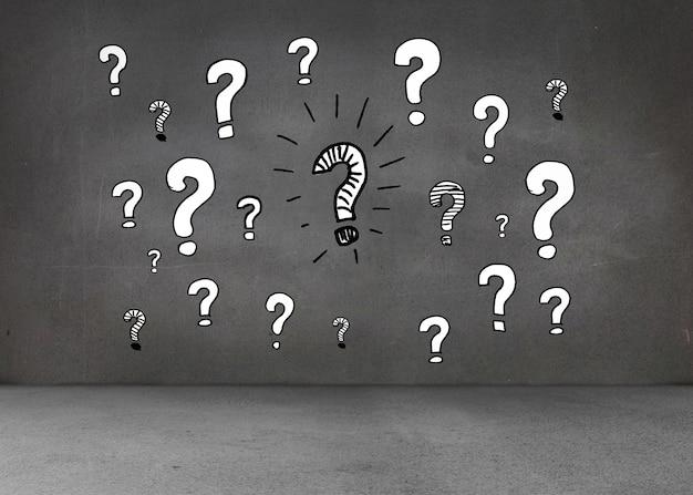 Pontos de interrogação brancos na parede escura