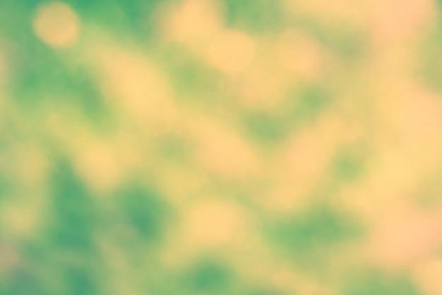 Pontos de luz abstratos verdes e amarelos podem ser usados como plano de fundo. filtro instragram